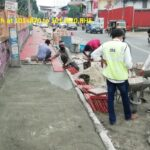 Fixing of tiles for footpath at 101+870 to 101+820,RHS.