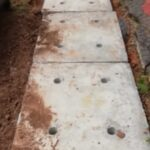 Drain slab laying